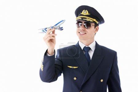 Photo pour Le pilote modèle d'avion sur un fond blanc - image libre de droit