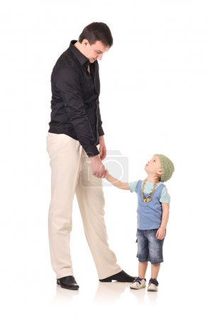 Photo for Man and little boy shaking hands isolated on the white - Royalty Free Image