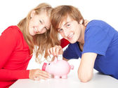 Teenage couple and piggy bank