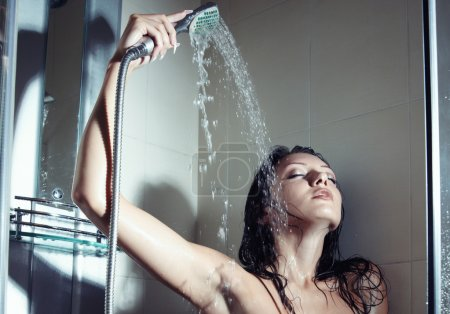 Photo for Young wet lady indoors taking shower - Royalty Free Image
