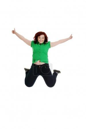 Jumping happy woman