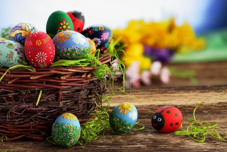 Photo for Easter eggs and natural wooden country table, background and texture - Royalty Free Image
