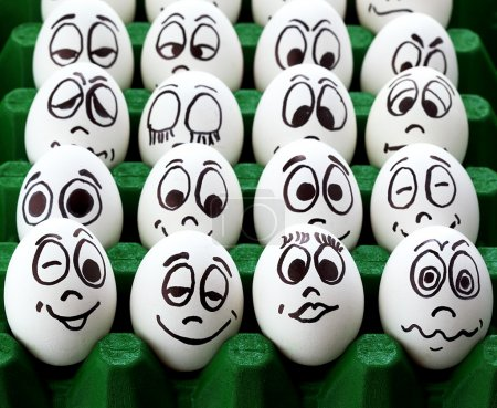 Photo for White easter eggs and funny faces - Royalty Free Image