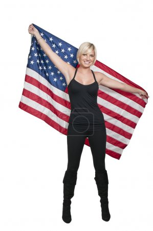 Photo for A beautiful young woman holding an American flag - Royalty Free Image