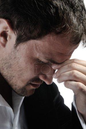 Desperate man with headache