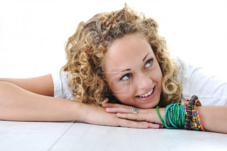 Teenage girl lying and smiling