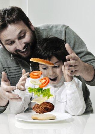 Retro photo of dad and son making hamburger