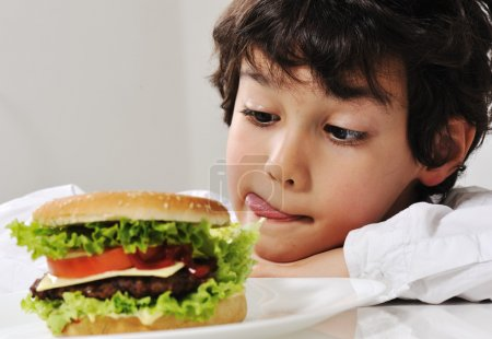 Photo for Boy on temptation with burger - Royalty Free Image