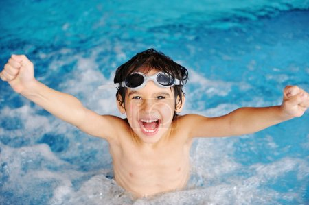 Super happy boy inside the swimming pool