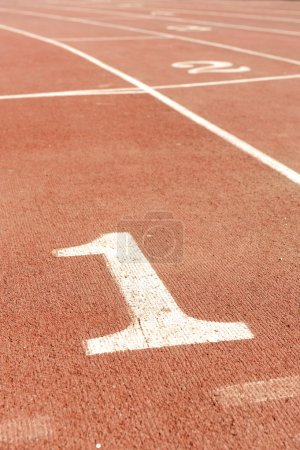Numbers on running track, one 1 for winner