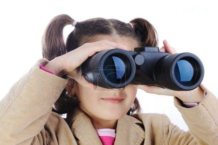 Little girl with binoculars