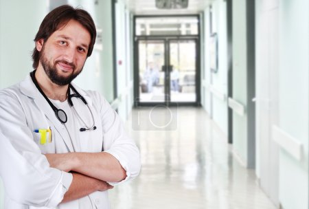 Young positive doctor on his workplace