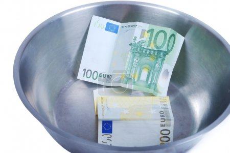 Money in dish prepared for cooking