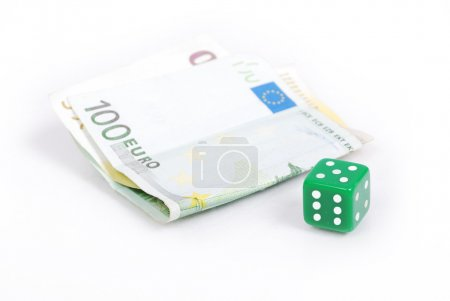 Euro currency and gamble cube isolated