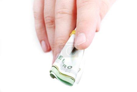 Photo pour Euro entre doigts mâles isolés - image libre de droit
