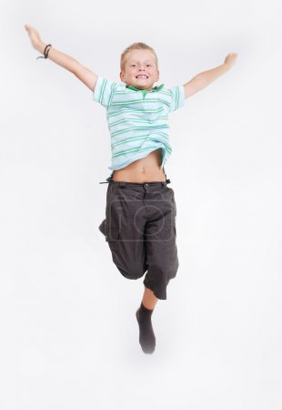Happy child is jumping high, isolated