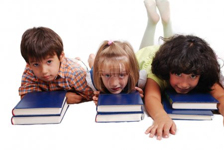 Three children laying down on books, isolated