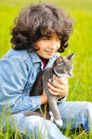 Photo for Very cute little girl with cat on meadow - Royalty Free Image