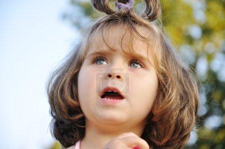 Very cute very little girl outdoor, closeup