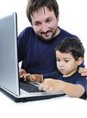 Father and son on laptop