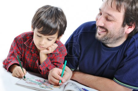 Cute child is painting and playing with his father