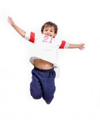 Very happy little cute child is jumping