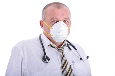 Positive elderly male doctor in characteristic clothes with a mask on face