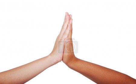 Photo for Two children hands touching each other, isolated - Royalty Free Image