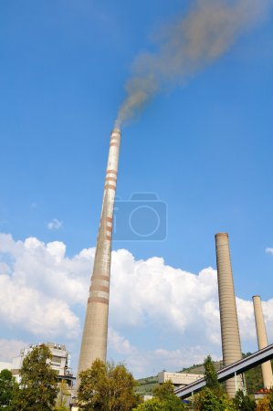 Two chimneys, industry, smoke against sky