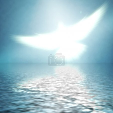 Photo for Shining dove with rays on a blue background - Royalty Free Image