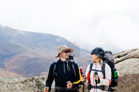 Man and woman hiking in mountains