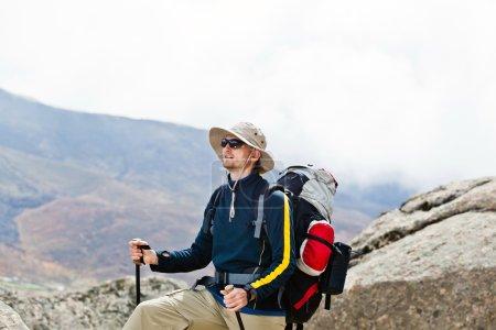 Man hiking in mountains, Himalayas in Nepal