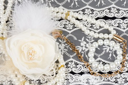 Vintage lace with flowers and beads on white background