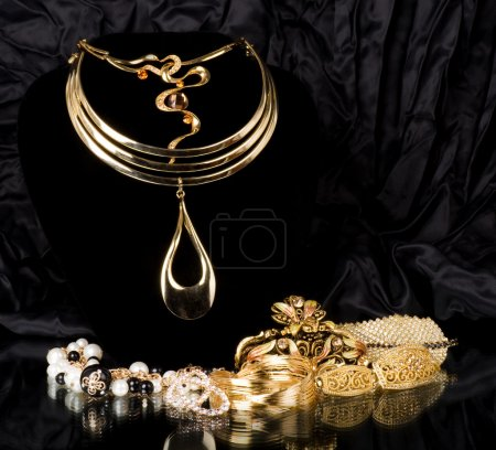 Photo for Golden jewelry on black background - Royalty Free Image