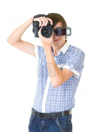 Young man photographer doing photos by digital camera