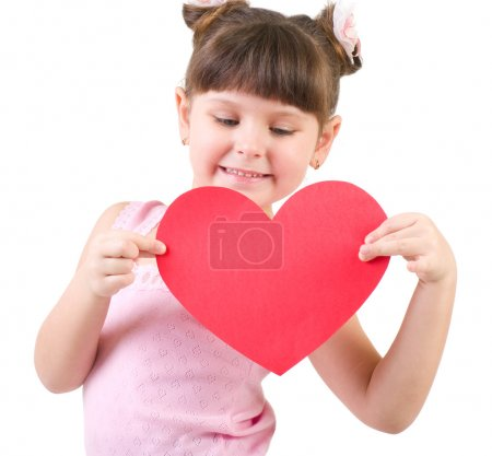 Happy little girl with red heart isolated on white