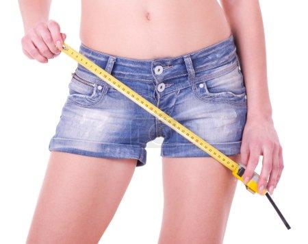 Yellow measure on beautiful woman shorts