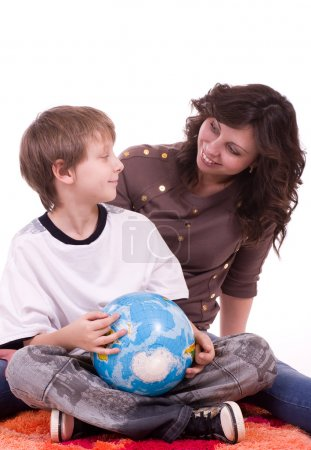 Little schoolboy and mother with globe