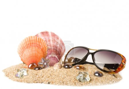 Beautiful exotic shell, crystals and glasses on sand