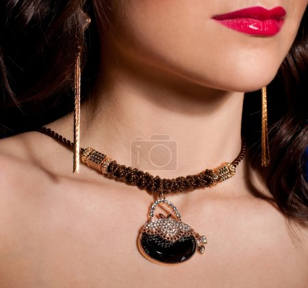 Portrait of a beautiful lady with golden jewelry