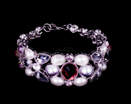 Beautiful bangle with pearls on black background