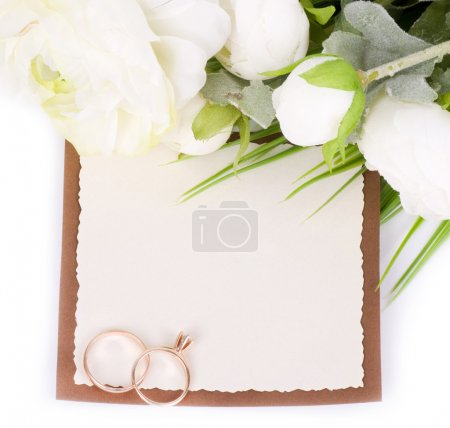 Photo for Gold wedding rings on a bouquet of white roses with banner add - Royalty Free Image