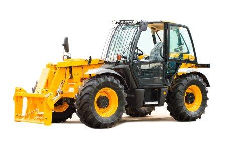 Photo pour Gros plan tracteur jaune neuf, isolé sur blanc - image libre de droit