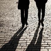 Shadows of walking in a street