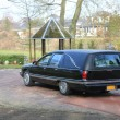 A black American hearse on a graveyard...