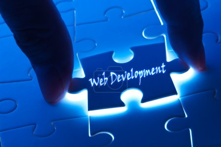 Photo for Web development word on puzzle piece with back light - Royalty Free Image