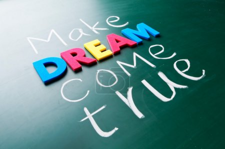 Photo for Make your dream come true. Colorful words on blackboard. - Royalty Free Image