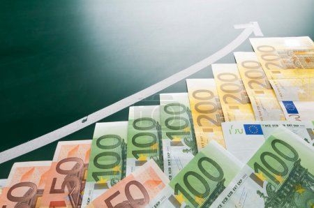 Photo for Euro banknotes and growing arrow on blackboard - Royalty Free Image