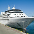 A large white steamship is in port of city Odessa...