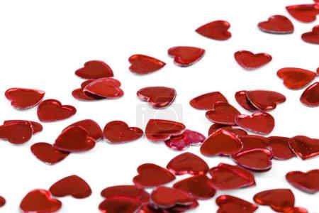 Confetti hearts on white background